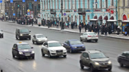 Stock Video Footage of Day car traffic and crowdy pavement of Nevsky prospect