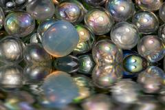Sunken iridescent glass beads Stock Illustration