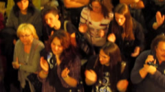 Mass of people applauding in a show at the fair exhibition - stock footage