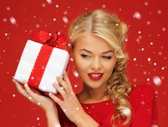 lovely woman in red dress with present - stock illustration