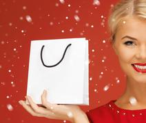 Stock Illustration of lovely woman in red dress with shopping bag