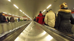 People on escalators in the subway Stock Footage