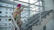 Stock Video Footage of Old lady walks up the stairs