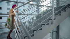 Old lady slowly walks up the stairs Stock Footage