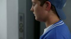 Kid entering an elevator Stock Footage