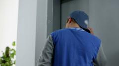 Kid waits an elevator nervously Stock Footage