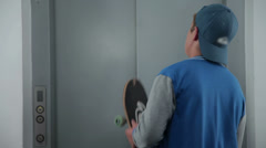 Boy nervous while waiting for his elevator lift Stock Footage