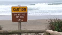 Caution Sign at Ocean Beach Stock Footage
