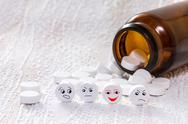 Stock Photo of tablets with smiley face in medical bottle