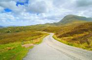 Stock Photo of highlands of scotland narrow road landscape, uk