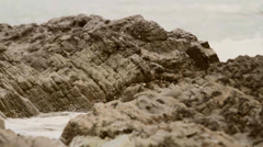 Wave striking the rock Stock Footage