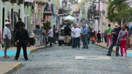 Stock Video Footage of Old San Juan city cobblestone street people HD 0584