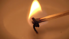 A candle is lit in slow motion Stock Footage