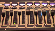 Stock Video Footage of Sound console in use, digital audio mixer in recording studio
