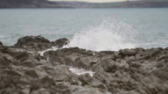 Wave striking the rock - stock footage