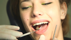 Woman having a check up at dentist's surgery Stock Footage