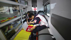 Paramedics preparing equipment - stock footage
