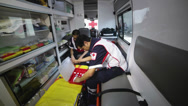 Stock Video Footage of Paramedics preparing equipment