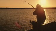 Stock Video Footage of Fisherman catch a fish