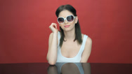 Stock Video Footage of Beautiful young woman in trendy sunglasses