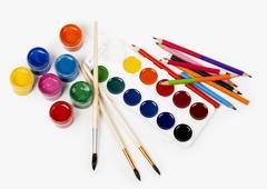 Pencils colour and gouache of paint Stock Photos