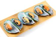 Stock Photo of mussel in bamboo dish.