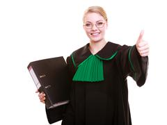 Lawyer attorney wearing classic polish black green gown showing thumb up Stock Photos