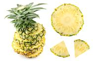 Stock Photo of pineapple slice on white background.