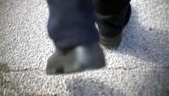 Close Up Of Man's Feet Walking Stock Footage