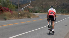 Stock Video Footage of RAAM competitor on the track