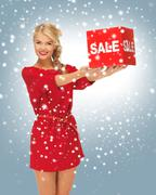 lovely woman in red dress with sale sign - stock illustration