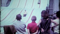 336 - the family enjoys this big slide - vintage film home movie Stock Footage