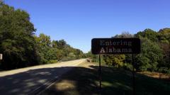 Entering Alabama sign Stock Footage
