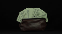 Purse with dollars on a white background revolves loop Stock Footage