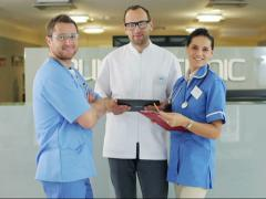 Group of medical workers consulting something in hospital Stock Footage