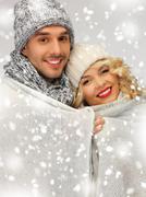 family couple under warm blanket - stock illustration