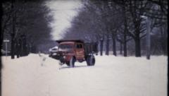 230 - a snow plow works clearing neighbor streets - vintage film home movie Stock Footage