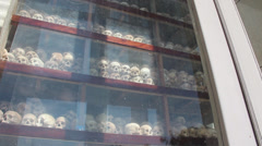 KHMER ROUGE ASIA: Zoom out from skulls on display Stock Footage