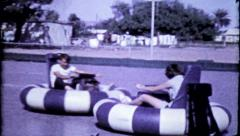 331 - teenagers crashing each other with bumper cars - vintage film home movie Stock Footage