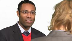 African American male talks with Older female boss. - stock footage