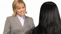 Older female boss interviews female applicant Stock Footage