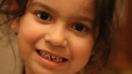 Stock Video Footage of little Girl wiggles her first loose tooth.