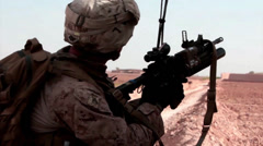 A marine fires a smoke grenade in Afghanistan Stock Footage