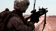 Stock Video Footage of A marine fires a smoke grenade in Afghanistan