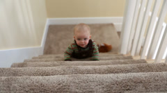 Toddler playing on stairs Stock Footage