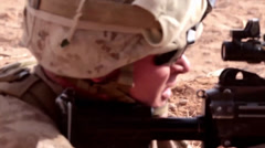 Marine fires his machine gun in support during a Firefight Stock Footage