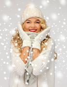 beautiful woman in hat, muffler and mittens - stock illustration