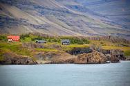 Stock Photo of icelandic landscape: houses in foggy mountains
