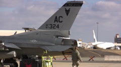 Ground crew preparing an F-16 Fighting Falcon for a mission Stock Footage