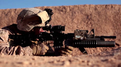 Soldier keeping watch looking through sights of rifle Stock Footage